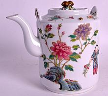 A CHINESE FAMILLE ROSE PORCELAIN TEAPOT AND COVER 20th Century, bearing Guangxu marks to base, painted with figures and bats. 6Ins high.