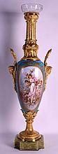 A FINE 19TH CENTURY SEVRES ORMOLU MOUNTED PORCELAIN VASE elegantly painted with classical scenes of figures within landscapes by G Poitevin, upon a well carved onyx base. 2Ft 6ins high.
