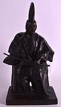 A LATE 19TH CENTURY JAPANESE MEIJI PERIOD BRONZE FIGURE OF AN ARCHER modelled in robes upon a rectangular base. Signed to reverse. 1Ft 3.5ins high.