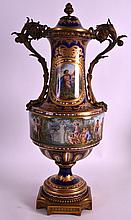 A MID 19TH CENTURY SEVRES EXHIBITION QUALITY TWIN HANDLED VASE painted with a continuous band of classical figures within a landscapes, mounted in fine ormolu. 1Ft 10.5ins high.