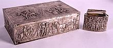 A 19TH CENTURY CONTINENTAL SOLID SILVER CIGAR BOX together with a matching lighter, decorated with figures on horseback. Box 8.5ins & Lighter 3.5ins wide. (2)
