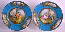 A PAIR OF 19TH CENTURY SEVRES PORCELAIN CABINET PLATES painted with figures upon a blue ground. 9.25ins diameter.