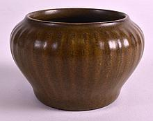 A 19TH CENTURY CHINESE TEA DUST BRUSH WASHER bearing Qianlong marks to base, with ribbed body and of globular form. 3.25ins diameter.