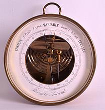 A SMALL EARLY 20TH CENTURY FRENCH ANDROID BAROMETER with white enamel dial. 5.25ins diameter.