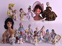 A COLLECTION OF ART DECO PORCELAIN DOLLS in various forms and sizes. (qty)