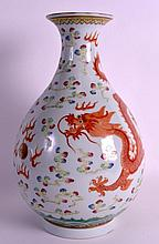 A GOOD CHINESE FAMILLE ROSE PORCELAIN YUHUCHUMPING DRAGON VASE Guangxu mark and probably of the period, painted with a dragon pursuing a flaming pearl. 12.25ins high.