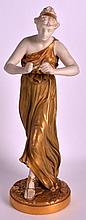 A 19TH CENTURY ROYAL WORCESTER MODEL OF A CLASSICAL FEMALE modelled in a gilt painted dress. 12.5ins high.