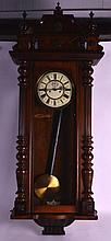 A 19TH/20TH CENTURY VIENNA WALNUT CASED REGUALTOR CLOCK with cream painted dial painted with black numerals. 3Ft 7ins long.