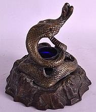 A 19TH CENTURY COLD PAINTED BRONZE INKWELL in the form of a coiled serpent. 6.5ins high.