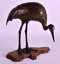 A 19TH CENTURY JAPANESE MEIJI PERIOD COLD PAINTED BRONZE HERON modelled upon a carved rootwood base. 8.75ins high.