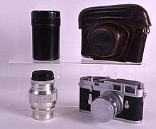 A GOOD LEICA ERNST LEITZ WETZLAR GERMAN CAMERA M3 No. 885062, together with a cased lens ( 4/135 No. 6405681).