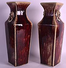 A PAIR OF 19TH/20TH CENTURY CHINESE FLAMBE GLAZED VASES with buddhistic mask head handles. 1Ft 4.5ins high.