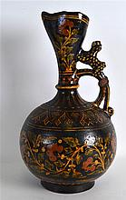 A 19TH CENTURY INDIAN TREACLE GLAZED EWER painted