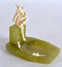 AN ART DECO EUROPEAN CARVED IVORY AND ONYX FIGURAL