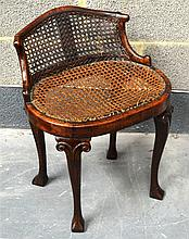 A QUEEN ANNE WALNUT LOW CHAIR with cane work suppo