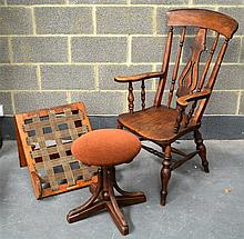AN ANTIQUE SMOKERS CHAIR together with an adjustab