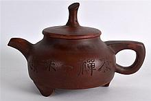 A CHINESE YIXING POTTERY TEAPOT AND COVER incised