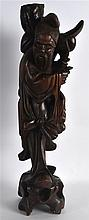 A LATE 19TH CENTURY CHINESE CARVED HARDWOOD FIGURE