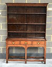 AN 18TH CENTURY COUNTRY OAK DRESSER with canted co