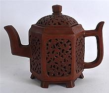A GOOD CHINESE QING DYNASTY RETICULATED YIXING TEA