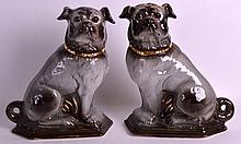 A PAIR OF VICTORIAN SCOTTISH BO'NESS POTTERY CHIMNEY PUG DOGS modelled with