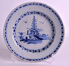 AN 18TH CENTURY DELFT POTTERY PLATE painted with a hut on an island. 8.75in