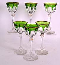 A SET OF SIX 1930S BOHEMIAN GREEN AND CLEAR GLASS GOBLETS with facetted ste
