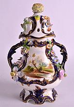 A MID 19TH CENTURY COALPORT TWIN HANDLED FLORAL ENCRUSTED VASE AND COVER pa