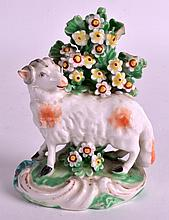 AN 18TH CENTURY DERBY PATCH MARK FIGURE OF A SHEEP modelled upon a painted