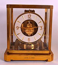 A JAEGAR LE COULTRE ATMOS CLOCK No. 106176. 9.25ins high.