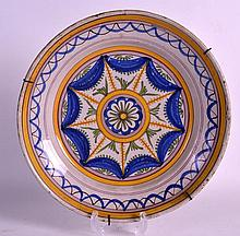 AN 18TH CENTURY EUROPEAN TIN GLAZED DISH painted with stylised yellow and b