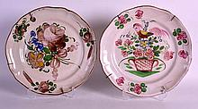 TWO 18TH/19TH CENTURY TIN GLAZED FLORAL PLATES. 11.5ins diameter.