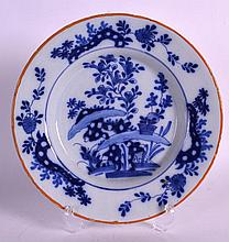 AN 18TH CENTURY DELFT TIN GLAZED DUTCH DISH painted with flowering rock. 9I