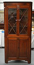A LARGE ANTIQUE OAK CORNER CABINET with glass fronted doors. 6Ft 8ins x 3ft