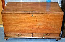 A GEORGE III CARVED MAHOGANY TRUNK with rising top and brass handles. 3Ft 1