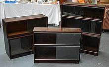 A SET OF THREE RETRO BOOKCASES. (3)