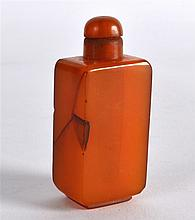 A RARE CHINESE QING DYNASTY CARVED AMBER SNUFF BOTTLE AND STOPPER of square