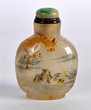 AN EARLY 20TH CENTURY CHINESE REVERSE PAINTED SNUFF BOTTLE AND STOPPER deco