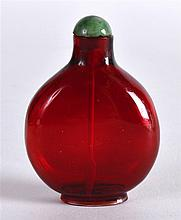 AN EARLY 19TH CENTURY CHINESE RUBY GLASS SNUFF BOTTLE AND STOPPER of elegan