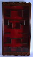 AN EARLY 20TH CENTURY CHINESE CARVED HARDWOOD SNUFF BOTTLE CABINET with scr