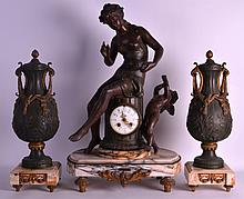 A LARGE EARLY 20TH CENTURY SPELTER CLOCK GARNITURE modelled as a female beside a winged cupid, the urns mounted with swags. Clock 2ft 2ins high.