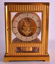 AN UNUSUAL JAEGER LE COULTRE BRASS ATMOS CLOCK. No. 66492. 9.25ins high.