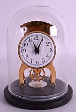 A BRASS DOME CASED MANTEL CLOCK. 6Ins high.