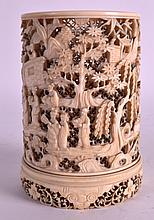 A FINE 19TH CENTURY CHINESE CARVED CANTON IVORY BRUSH POT Qing, decorated with various figures under flowering trees and floral motifs. 5.25ins high.