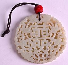 AN EARLY 20TH CENTURY CHINESE CARVED JADE PENDANT with coral mounts. 3.5ins diameter.