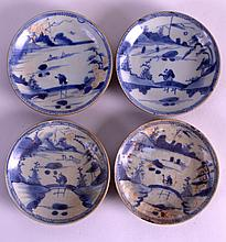 A SET OF FOUR 18TH CENTURY CHINESE CA MAU CARGO SAUCERS with cafe au lait backing, painted with a figure on a bridge over a lake. 4.25ins diameter. (4)