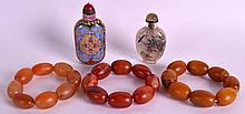 A PAIR OF CHINESE CARVED AGATE BRACELETS 20th Century, together with another and two snuff bottles. (5)