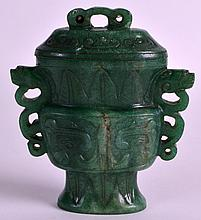 AN EARLY 20TH CENTURY CHINESE CARVED GREEN JADE VASE AND COVER Qing, of archaic form with taotie carved decoration. 3.75ins high.