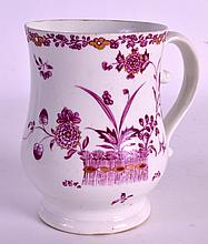 AN 18TH CENTURY DERBY SILVER SHAPED MUG painted in puce with a fence and flowers. 4.25ins high.