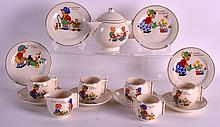AN ART DECO ENGLISH CHILDS TEA SERVICE printed with Nursery scenes, with angular handles. (16)